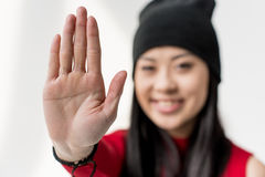 Portrait of happy attractive asian woman showing stop sign isolated Royalty Free Stock Photos
