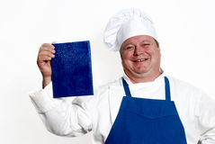 Portrait of happy attractive cook with book Royalty Free Stock Photography