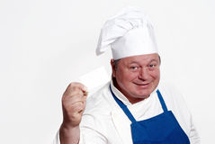 Portrait of happy attractive cook with card Royalty Free Stock Photo