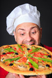 Portrait of happy attractive cook with a pizza Stock Photos