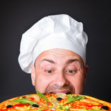 Portrait of happy attractive cook with a pizza Royalty Free Stock Photos