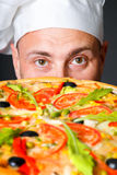 Portrait of happy attractive cook with a pizza Stock Image