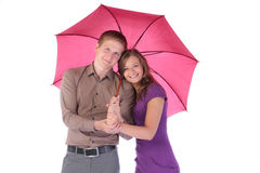 Portrait of happy attractive couple man and woman under umbrella. Portrait of happy attractive couple men and women under umbrella on white background Royalty Free Stock Photo