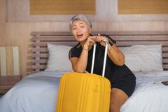 Portrait of happy and attractive 40s to 50s mature Asian tourist woman with grey hair arriving in hotel room in business or. Travel and explore . natural royalty free stock photos
