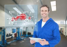Portrait of happy automobile mechanic holding digital tablet in workshop and mechanic interface. Digital composition of happy automobile mechanic holding digital Stock Photography