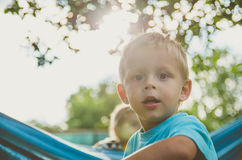 Baby boy playing in the garden. Happy little child. Stock Photo