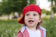 Portrait of happy baby boy in summer Stock Image