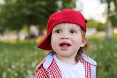 Portrait of happy baby boy in summer Stock Image