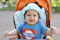 Portrait happy baby in buggy. Horizontal Royalty Free Stock Photo