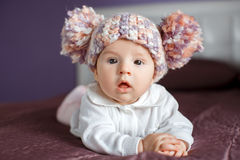 Portrait of a happy baby crawling on the bed Royalty Free Stock Photo
