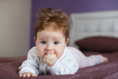 Portrait of a happy baby crawling on the bed Royalty Free Stock Image