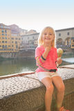 Portrait of happy baby girl eating ice cream near ponte vecchio Royalty Free Stock Images