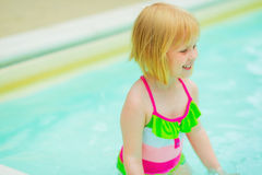 Portrait of happy baby girl in swimming pool Royalty Free Stock Photos