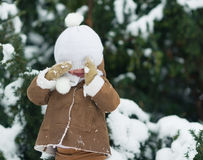 Portrait of happy baby with hat over eyes in winter park Stock Photos
