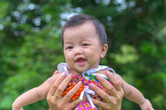 Portrait of happy baby at public park outdoor Stock Image