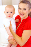 Portrait of happy baby and smiling mommy. Portrait of baby and smiling mommy Royalty Free Stock Photo