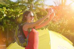 Portrait of happy backpacker girl with photo camera Royalty Free Stock Images
