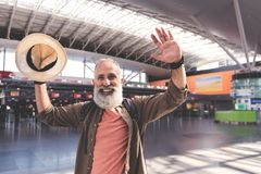 Outgoing unshaven retire waving with arms Stock Photography