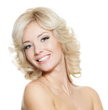 Portrait of happy beautiful blonde woman. Beautiful happy portrait of an young smiling blonde woman - isolated on white stock photography