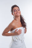 Portrait of happy beautiful bride corrects dress Royalty Free Stock Images