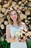 Portrait of a happy beautiful bride with a wedding bouquet Royalty Free Stock Photos