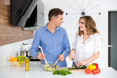 Portrait of a happy beautiful couple cooking together Royalty Free Stock Photo