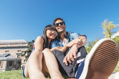 Portrait of happy beautiful couple  on park. Caucasian and chinese Royalty Free Stock Photos