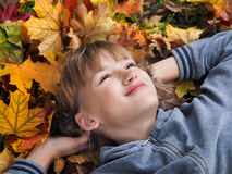 Portrait of happy beautiful girls among autumn leaves Royalty Free Stock Image