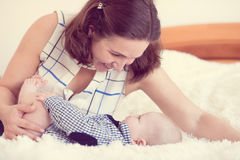 Portrait of happy beautiful mother and baby Stock Image