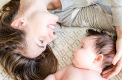 Portrait of happy beautiful mother and cute newborn baby girl Royalty Free Stock Photography