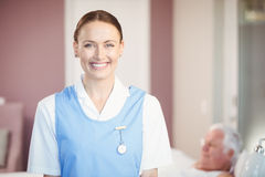 Portrait of happy beautiful nurse at home Royalty Free Stock Images