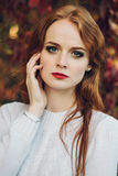 Portrait of happy beautiful redhaired girl smiling.  Royalty Free Stock Photo