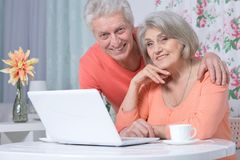 Beautiful senior couple using laptop Stock Photo