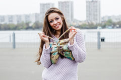 Portrait of happy beautiful smiling woman with bag on urban background Royalty Free Stock Image