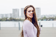 Portrait of happy beautiful smiling woman on urban background Royalty Free Stock Image
