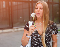 Portrait happy beautiful woman blowing dandelion. Portrait happy beautiful young woman blowing dandelion. Summer. Outdoor Stock Images