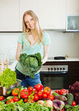 Portrait of happy beautiful woman with raw vegetables stock image