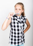 Portrait of happy beautiful young girl with sweet candys. pretty young girl dressed in a plaid shirt holding colorful Royalty Free Stock Photography