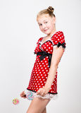 Portrait of happy beautiful young girl with sweet candys. pretty young woman dressed in a red dress with white polka Royalty Free Stock Photos