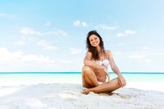 Portrait of a happy young woman posing while on the beach Royalty Free Stock Photo