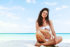 Portrait of a happy young woman posing while on the beach Stock Photo