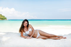 Portrait of a happy young woman posing while on the beach. Portrait of a happy beautiful young woman posing while on the beach Stock Photo