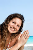 Portrait of a happy young woman posing while on the beach. Portrait of a happy beautiful young woman posing while on the beach Stock Photography