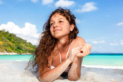 Portrait of a happy young woman posing while on the beach Stock Photography