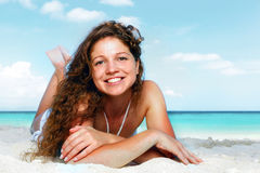 Portrait of a happy young woman posing while on the beach Stock Photos