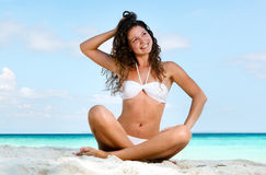 Portrait of a happy young woman posing while on the beach Royalty Free Stock Image