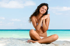 Portrait of a happy young woman posing while on the beach Stock Images