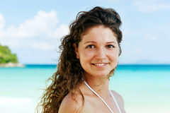 Portrait of a happy young woman posing while on the beach Stock Image