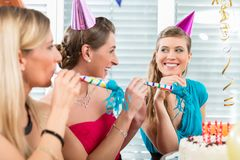 Portrait of a beautiful young woman celebrating her birthday. Portrait of a happy and beautiful young women celebrating her birthday with her best female friends royalty free stock images