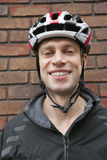 Portrait of happy biker wearing crash helmet Stock Photography